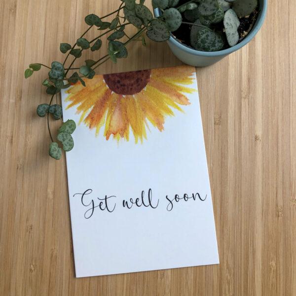 Wenskaart get well soon zonnebloem met een plantje.
