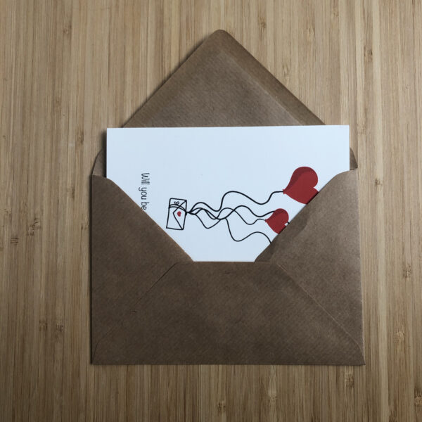 Wenskaart valentijns post, half in een kraft envelop gestoken.
