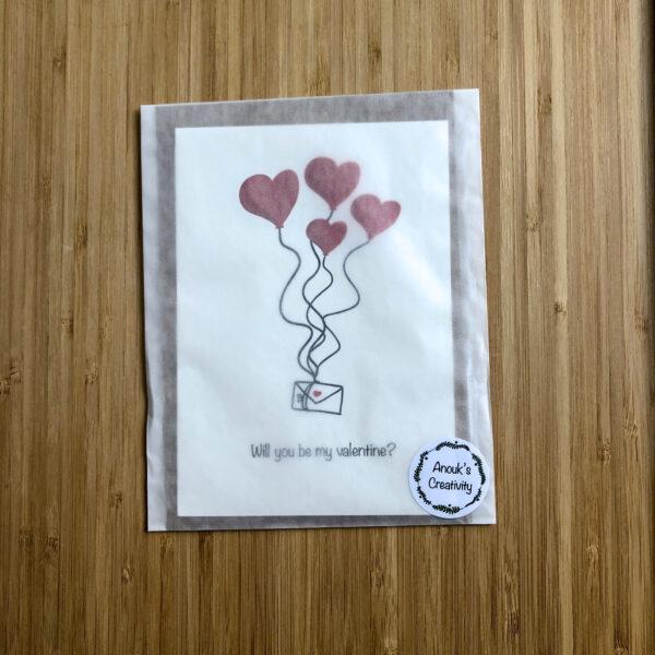 Wenskaart valentijns post, verpakt in een pergamijn zakje.